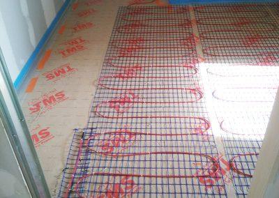 Chantier de plancher chauffant rayonnant électrique